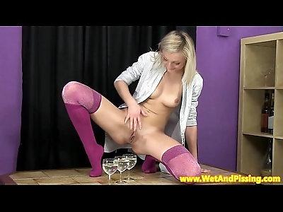 Urinedrinking blonde beauty in hot longsocks