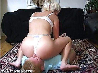 Blonde mistress is horny as shes seated on a mans face