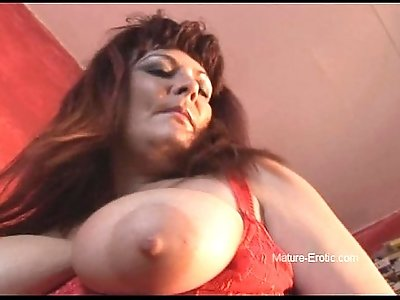 Busty babe strips and spreads her shaved pussy