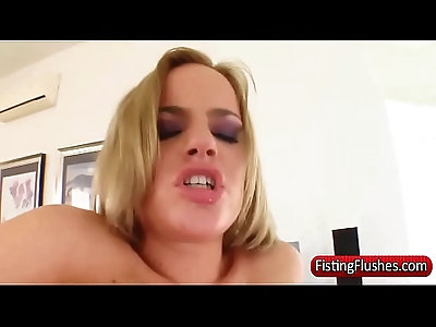 Stockings clad lesbo gets fisted