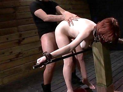 Bound redhead Velma DeArmond deep in her throat fucked