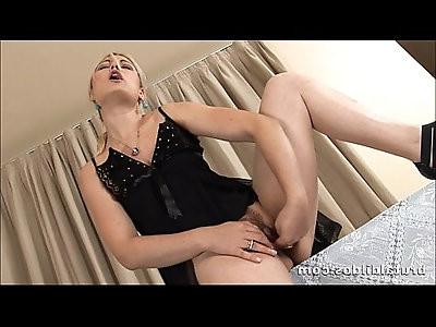 Blonde Ionella Inserting A Thick Dildo