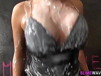Gloryhole whore rubs her cunt